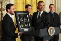 Jimmie gives gloves to the President on September 7, 2011 in Washington, DC.