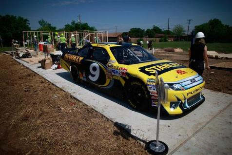 Marcos Ambrose Hammering for Habitat on April 11, 2012 in Fort Worth, Texas