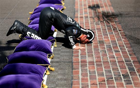 jimmie-johnson-kisses-bricks-brickyard-indy-2012