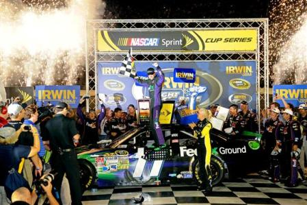 2012 Bristol2 Denny Hamlin Celebrates In Victory Lane