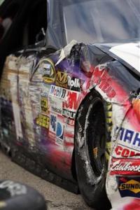 denny-hamlin-damage-kansas-speedway-test-2012