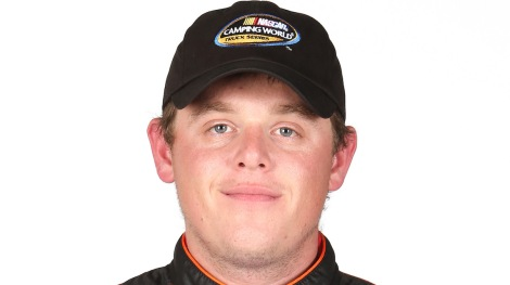DAYTONA BEACH, FL - FEBRUARY 19:  NASCAR Camping World Truck Series driver Spencer Gallagher poses for a portrait at Daytona International Speedway on February 19, 2014 in Daytona Beach, Florida.  (Photo by Todd Warshaw/NASCAR via Getty Images)