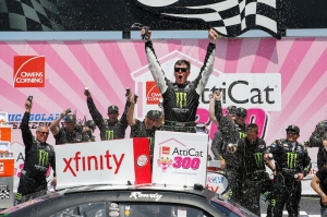 JOLIET, IL - JUNE 21:  Erik Jones, driver of the #54 Monster Energy Toyota, celebrates in Victory Lane after winning the NASCAR XFINITY Series Owens Corning AttiCat 300 at Chicagoland Speedway on June 21, 2015 in Joliet, Illinois.  (Photo by Kena Krutsinger/NASCAR via Getty Images)