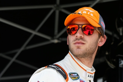 DOVER, DE - MAY 28:  Daniel Suarez, driver of the #51 ARRIS Toyota, stands in the garage area during practice for the NASCAR Camping World Truck Series Lucas Oil 200 at Dover International Speedway on May 28, 2015 in Dover, Delaware.  (Photo by Todd Warshaw/Getty Images)
