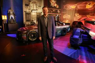 "Dale Earnhardt Jr. poses in front of his ""Batman v Superman: Dawn of Justice"" film-inspired No. 88 Batman Chevrolet at Warner Bros. Studios on Thursday, March 17, 2016, in Burbank, CA. (Photo by Eric Charbonneau/Invision for Warner Bros./AP Images)"
