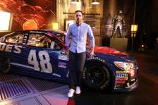 "Jimmie Johnson poses in front of ""Batman v Superman: Dawn of Justice"" film-inspired No. 48 Superman Chevrolet at Warner Bros. Studios on Thursday, March 17, 2016, in Burbank, CA. (Photo by Eric Charbonneau/Invision for Warner Bros./AP Images)"