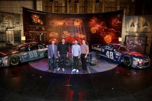 """Batman v Superman: Dawn of Justice"" stars Ben Affleck and Henry Cavill get an in-depth look at Dale Earnhardt Jr.'s film-inspired No. 88 Batman Chevrolet and Jimmie Johnson's No. 48 Superman Chevrolet at Warner Bros. Studios on Thursday, March 17, 2016, in Burbank, CA. (Photo by Eric Charbonneau/Invision for Warner Bros./AP Images)"