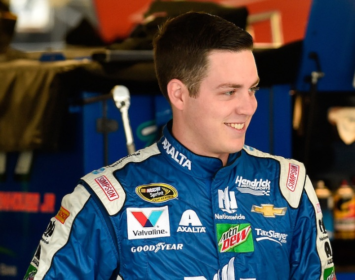 KANSAS CITY, KS - OCTOBER 14: Alex Bowman, driver of the #88 Nationwide Chevrolet, stands in the garage area during practice for the NASCAR Sprint Cup Series Hollywood Casino 400 at Kansas Speedway on October 14, 2016 in Kansas City, Kansas. (Photo by Jason Hanna/Getty Images)